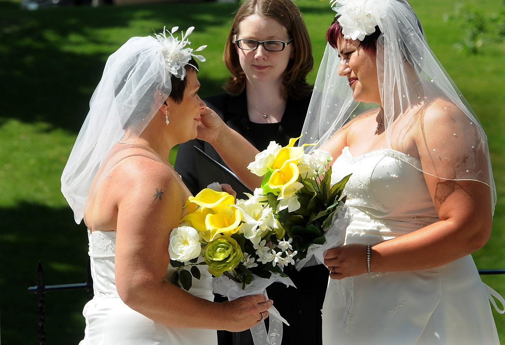 ". Rochelle Imdieke, right, wipes a tear from Shirley Otto\'s eye as wedding officiant Heather Fairbanks looks on after Rochelle sang ""From This Moment On\"" by Shania Twain at their wedding ceremony. Imdieke took Otto\'s name and is now Rochelle \""Shay\"" Otto.  (Pioneer Press: Jean Pieri)"