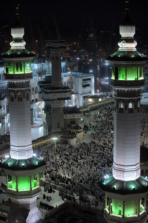 . A general view shows pilgrims performing evening prayers in Mecca\'s Grand Mosque on October 8, 2013, as more than two million Muslims have arrived in the holy city for the annual hajj pilgrimage. The hajj, which is one of the world\'s largest human assembly, begins on October 13 amid concerns over the deadly MERS coronavirus. (FAYEZ NURELDINE/AFP/Getty Images)