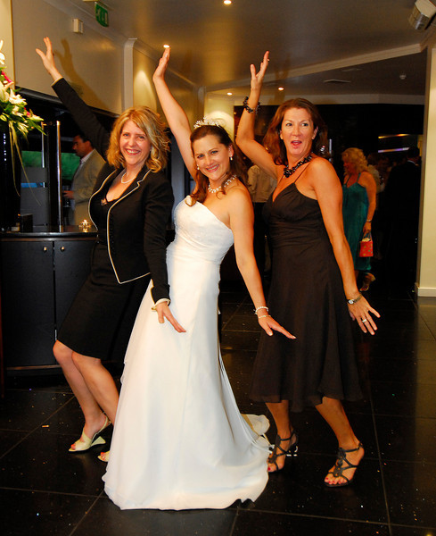 Bride and Friends, humorous pose at the wedding reception in Sandbanks,Dorset