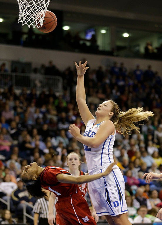 . Duke guard Tricia Liston (32) takes a shot as Nebraska guard Tear\'a Laudermill (1) reacts during a regional semi-final of the NCAA college basketball tournament Sunday March 31, 2013, in Norfolk, Va.  (AP Photo/Steve Helber)
