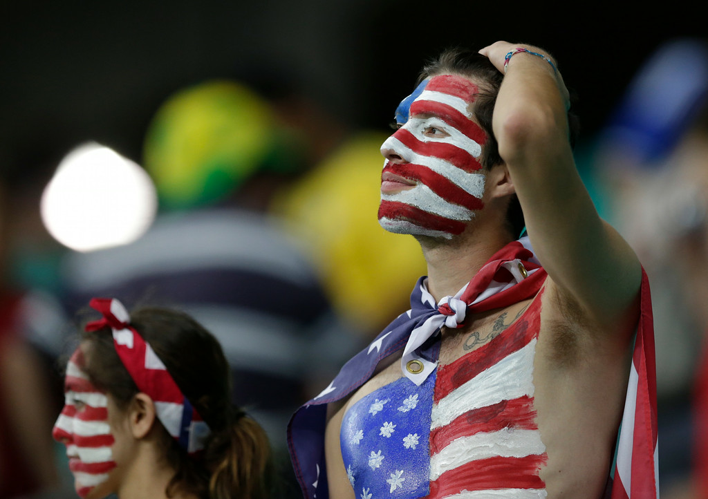 . US fans react after the World Cup round of 16 soccer match between Belgium and the USA at the Arena Fonte Nova in Salvador, Brazil, Tuesday, July 1, 2014. Belgium won the match 2-1 after extra-time.  (AP Photo/Julio Cortez)