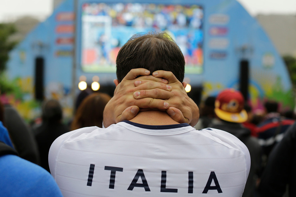 . An Italy soccer fan watches his team\'s World Cup match with Costa Rica inside the FIFA Fan Fest area in Sao Paulo, Brazil, Friday, June 20, 2014. Italy lost 1-0 to Costa Rica. (AP Photo/Nelson Antoine)