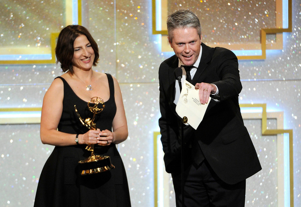 . David McGuire, right, accepts the award for outstanding legal/courtroom program for ìThe Peopleís Courtî at the 41st annual Daytime Emmy Awards at the Beverly Hilton Hotel on Sunday, June 22, 2014, in Beverly Hills, Calif. (Photo by Chris Pizzello/Invision/AP)