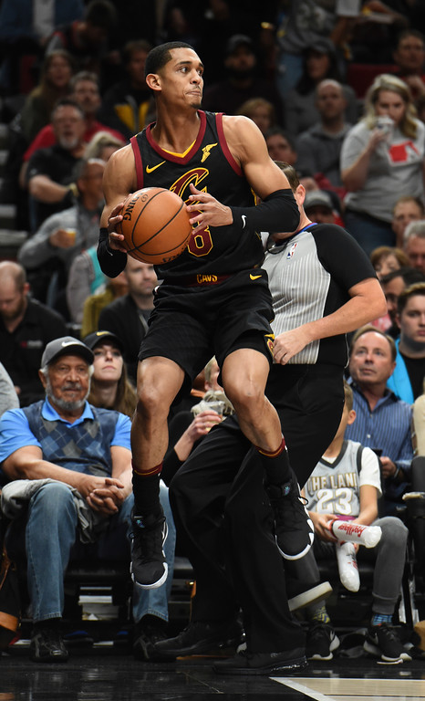 . Cleveland Cavaliers guard Jordan Clarkson saves a ball from going out of bounds during the first half of an NBA basketball game against the Portland Trail Blazers in Portland, Ore., Thursday, March 15, 2018. (AP Photo/Steve Dykes)