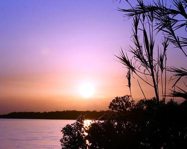 Sun Setting over  Blue Water Bay