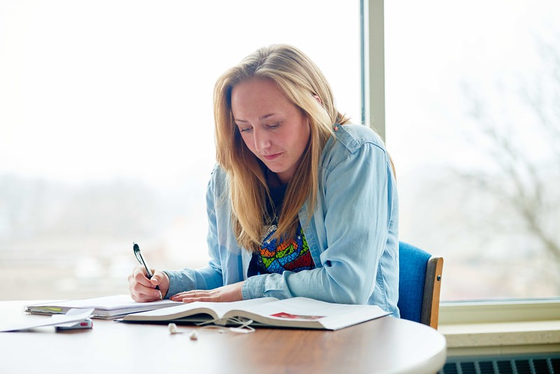-UWL UW-L UW-La Crosse University of Wisconsin-La Crosse; Chair; day; Desk; Inside; Lifestyle; Notepad; November; Phone Cell Smartphone; Portrait; Reading; Residence dorm; snowy; Student students; Studying; Woman women