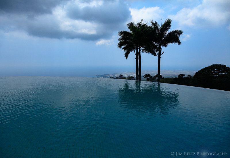 Infinity-edge pool and great view from 1500 ft above Kona, at Mauka Meadows Coffee Farm.