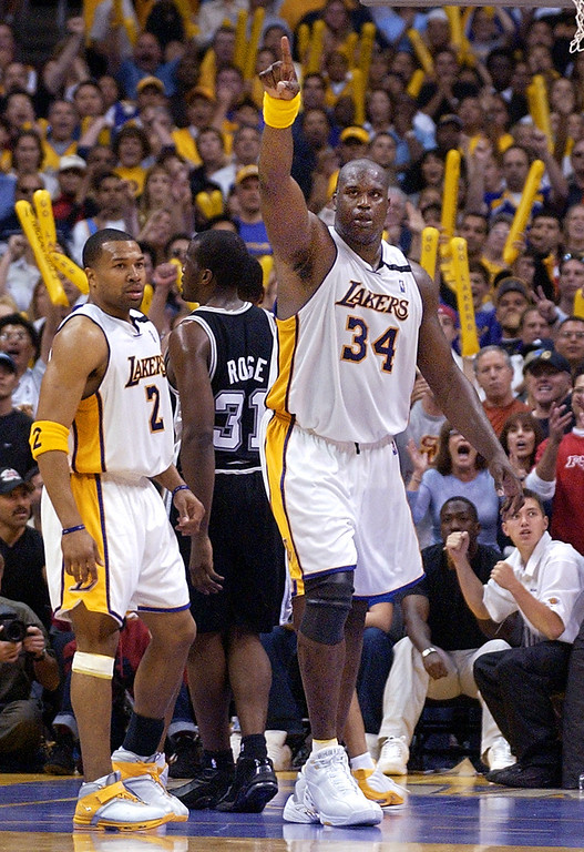 . Los Angeles Lakers\' Shaquille O\'Neal gestures in the closing seconds as teammate Derek Fisher, left, and San Antonio Spurs\' Malik Rose look on in their Western Conference Semi-Finals game, Saturday night, May 11, 2003, in Los Angeles. The Lakers won the game 99-95 to tie the series at 2-2. (AP Photo/Mark J. Terrill)