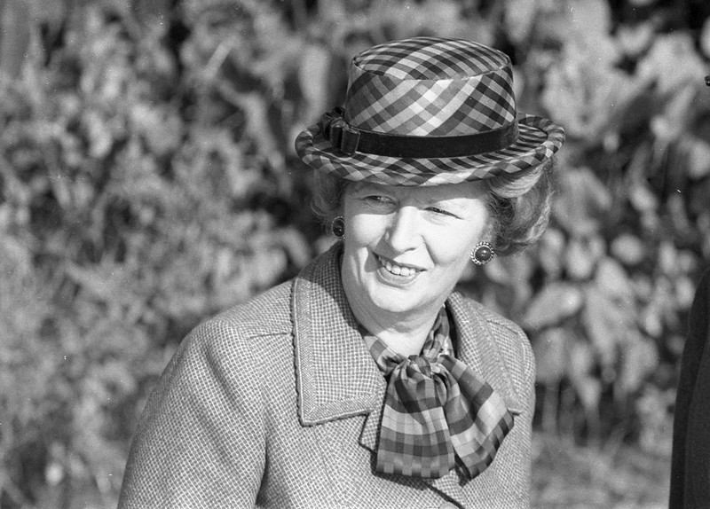 . Then Britain\'s Prime Minister Margaret Thatcher wears a checkered green hat on her 60th birthday as she attends church near her official country residence, Chequers, near Aylesbury, England in this October 13, 1985 file photo. Thatcher has died following a stroke, a spokesman for the family said. REUTERS/Brian Smith/Files