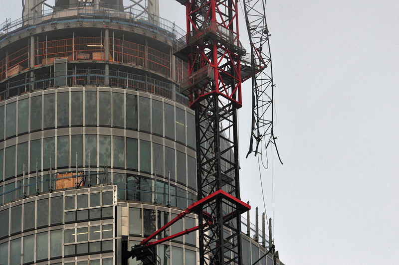 . A damaged crane that was hit by a helicopter is pictured following the crash in central London on January 16, 2013. Two people were killed after a helicopter hit a crane at a building site and plunged to the ground in a ball of flames, police said.   CARL COURT/AFP/Getty Images