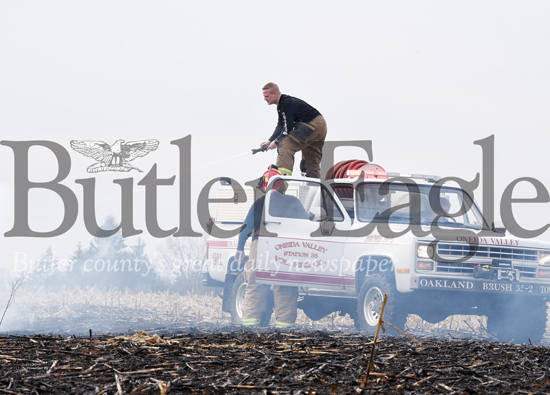 Harold Aughton/Butler Eagle: Firefighters from Unionville and Onieda Valley responded to a brush fire on Spryn farms along Sunset Road Monday, February 24, 2020.