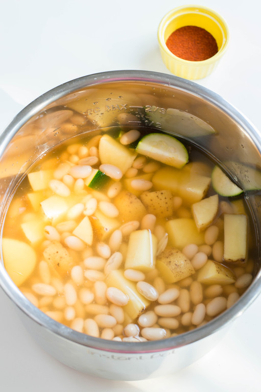 This Autumn Vegetable Soup is made easily in the Instant Pot and contains all of the hearty & seasonal vegetables you're craving this time of year. #recipe