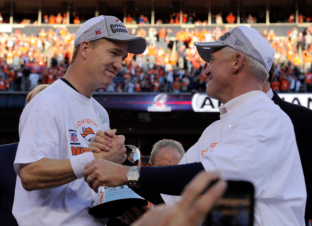 . Denver Broncos quarterback Peyton Manning (18) is congratulated by Denver Broncos head coach John Fox after the Broncos won the 2014 AFC Championship game.  Photo by Helen Richardson/The Denver Post)