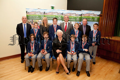 2013 Ulster Mini Boys Champions are pictured with Dame Mary Peters,Declan Mussen (Coach), Cormac Mc Kinney,Brian Kane (Coach),Lisa Quinn (Coach). R1339001