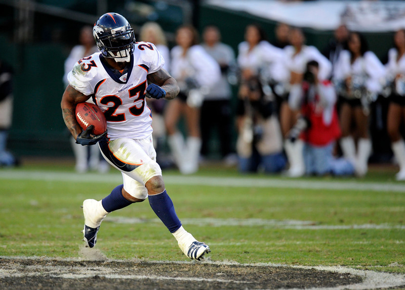 . Denver Broncos running back Willis McGahee (23) find a big hole in the Oakland Raiders defense and runs for a 60-yard touchdown November 6, 2011 at O.co Coliseum in Oakland. John Leyba, The Denver Post