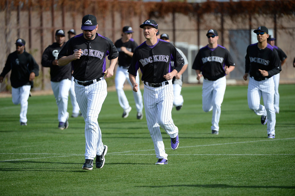 . SCOTTSDALE, AZ. - FEBRUARY 19: Colorado Rockies Todd Helton (17) and Troy Tulowitzki (2) run during conditioning during Spring Training February 19, 2013 in Scottsdale. (Photo By John Leyba/The Denver Post)