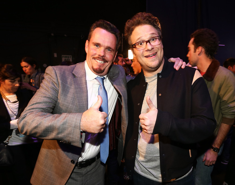 . Actors Kevin Dillon (L) and Seth Rogen attend the 2014 MTV Movie Awards at Nokia Theatre L.A. Live on April 13, 2014 in Los Angeles, California.  (Photo by Christopher Polk/Getty Images)