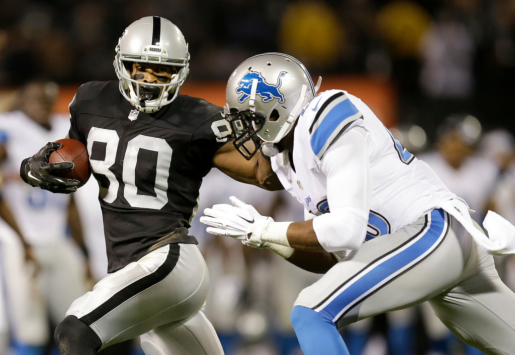. Oakland Raiders wide receiver Rod Streater (80) runs against Detroit Lions defensive back Jerome Couplin during the second quarter of an NFL preseason football game in Oakland, Calif., Friday, Aug. 15, 2014. (AP Photo/Ben Margot)