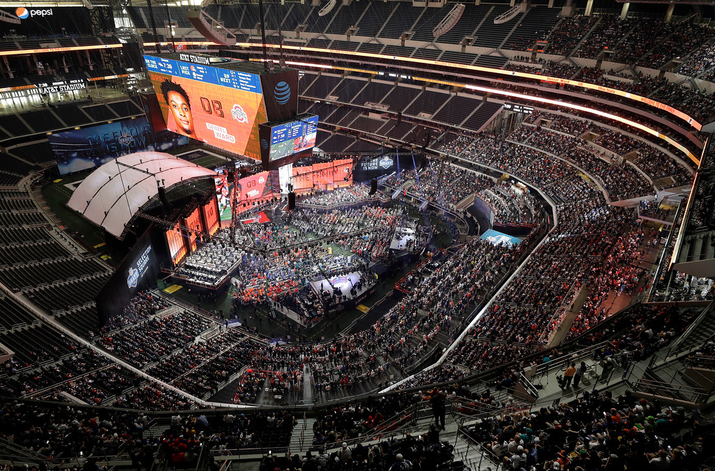 . Ohio State\'s Denzel Ward is shown on the screen after he was selected by the Cleveland Browns during the first round of the NFL football draft, Thursday, April 26, 2018, in Arlington, Texas. (AP Photo/David J. Phillip)