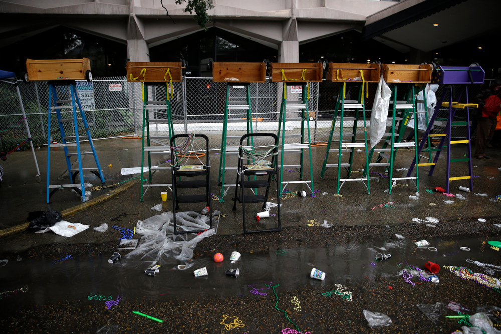 Description of . Empty children's ladders sit as parades roll by on St. Chrales Ave. during Mardi Gras in New Orleans, Tuesday, March 4, 2014. Rain and unusually cold temperatures kept most of the normally massive and festive crowds away.  (AP Photo/Gerald Herbert)