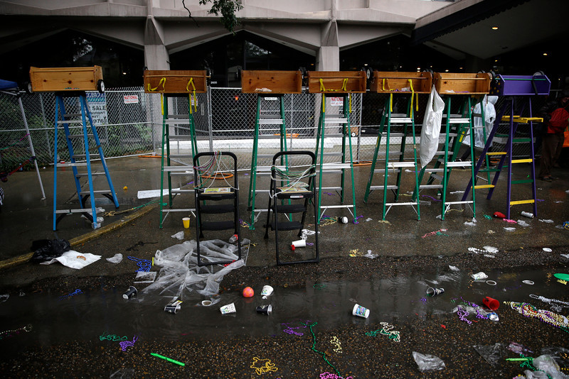 . Empty children\'s ladders sit as parades roll by on St. Chrales Ave. during Mardi Gras in New Orleans, Tuesday, March 4, 2014. Rain and unusually cold temperatures kept most of the normally massive and festive crowds away.  (AP Photo/Gerald Herbert)