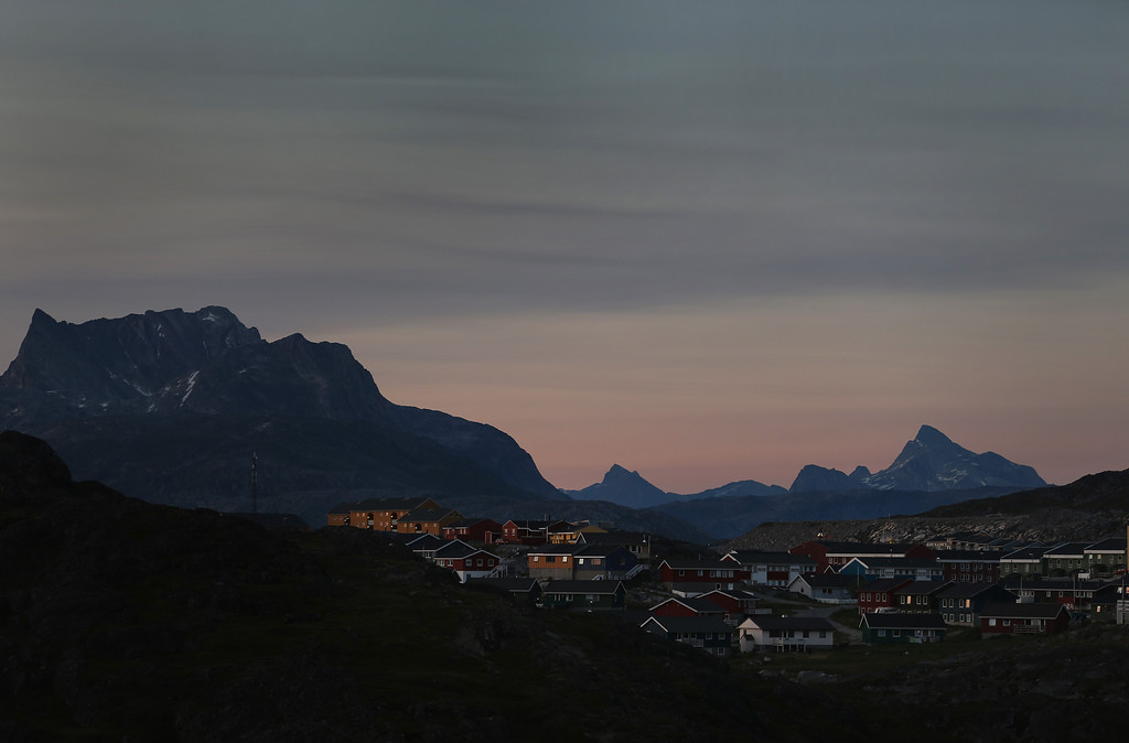 . Homes are seen against the backdrop of mountains on July 28, 2013 in Nuuk, Greenland. (Photo by Joe Raedle/Getty Images)