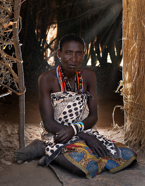 The Hadzabe people live in caves near Lake Eyasi, and their isolation and shrinking numbers have allowed them to avoid the HIV epidemic  and other diseases that have spread due to intertribal marriages.  An interesting facet of Hadzabe culture is their language. Believed to have some kind of relation to the Bushmen of the Kalahari Desert, the Hadzabe language is a distinctive tongue of clicks that is similar to that of the famous Bushmen. Despite this and their similar physical appearances, DNA testing has shown no relation between the two groups.  Tanzania 2019