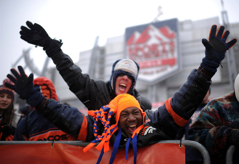 . Lee Davis, bottom, and his wife Taia attend the United in Orange Pep Rally at Sports Authority Field at Mile High in Denver on Friday. Denver. CO, January 11, 2013.  Hyoung Chang, The Denver Post