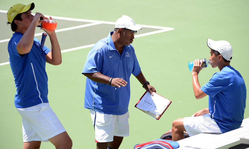 . San Marino\'s Robert Carter, left, and teammate Charles Deng, right, listen to head coach  Mel Pereira during a break against University\'s (Irvine) in a doubles match during the CIF State Tennis Championship at the Claremont Club in Claremont, Calif., on Saturday, May 31, 2014.  (Keith Birmingham/Pasadena Star-News)