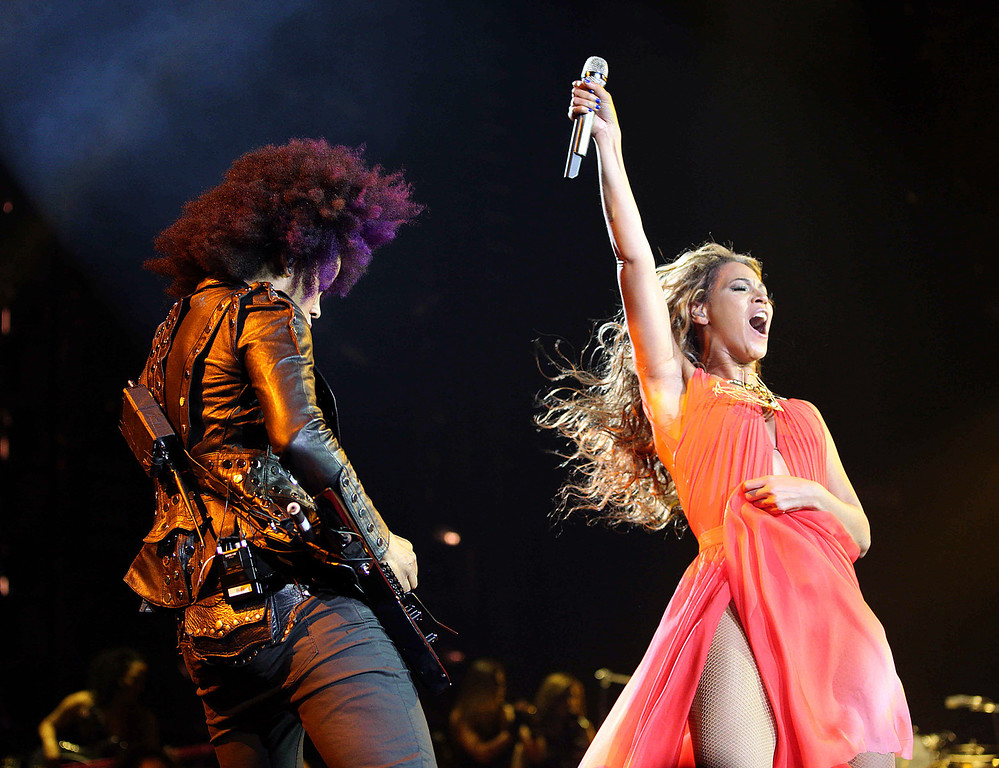 ". Singer Beyonce performs with guitarist Bibi on the opening night of her ""Mrs. Carter Show World Tour 2013\"", on Monday, April 15, 2013 at the Kombank Arena in Belgrade, Serbia. Beyonce is wearing an outfit by designer Alon Livne.(Photo by Yosra El-Essawy/Invision for Parkwood Entertainment/AP Images)"