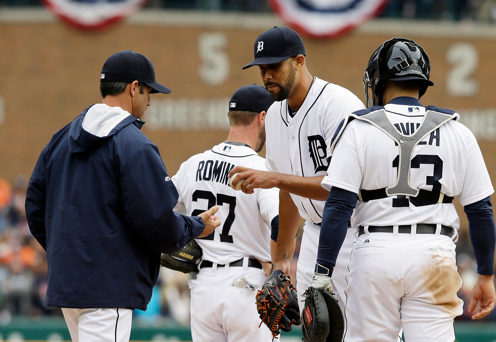 . Detroit Tigers starting pitcher David Price is relieved in the ninth inning of an opening day baseball game against the Minnesota Twins in Detroit, Monday, April 6, 2015. (AP Photo/Carlos Osorio)
