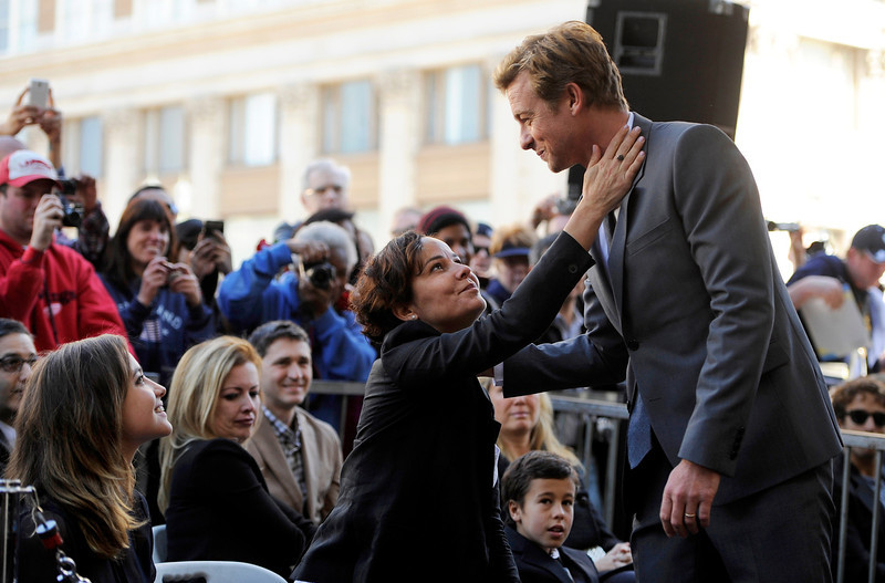 . Australian actor Simon Baker, right, is congratulated by his wife Rebecca during a ceremony to award him a star on the Hollywood Walk of Fame, on Thursday, Feb. 14, 2013 in Los Angeles. Looking on at far left is his daughter Stella. (Photo by Chris Pizzello/Invision/AP)