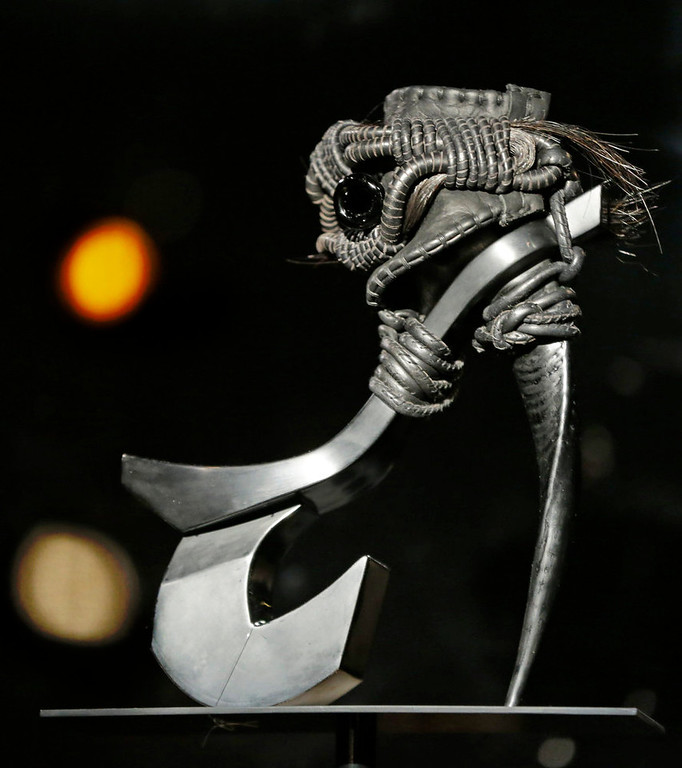 ". Masaya Kushino\'s ""Storm Horse\"" shoe, which features strands of a horse\'s mane, is displayed at the \""Shoe Obsession\"" exhibit at The Museum at the Fashion Institute of Technology Museum in New York. The exhibition, showing off 153 specimens, runs through April 13. (AP Photo/Kathy Willens)"