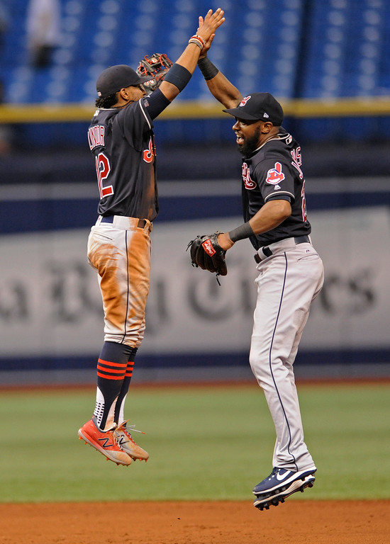 . Cleveland Indians\' Francisco Lindor, left, and outfielder Austin Jackson celebrate a win over the Tampa Bay Rays in a baseball game Friday, Aug. 11, 2017, in St. Petersburg, Fla. (AP Photo/Steve Nesius)