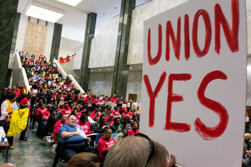 """In the Well at the State Capitol, hundreds crowded into a rally where speaker after speaker castigated the Governor for his plan to """"restructure"""" Downstate - a fancy term that means cuts, layoffs and closures."""