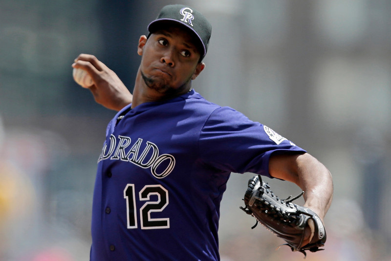. Colorado Rockies starting pitcher Juan Nicasio (12) delivers in the first inning of a baseball game against the Pittsburgh Pirates in Pittsburgh Sunday, Aug. 4, 2013. (AP Photo/Gene J. Puskar)