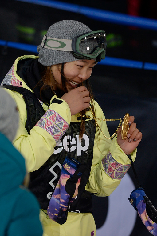 . Gold medalist Chloe Kim reacts to receiving her hardware after the women\'s snowboard half pipe final. Winter X Games on Saturday, January 24, 2015. (Photo by AAron Ontiveroz/The Denver Post)
