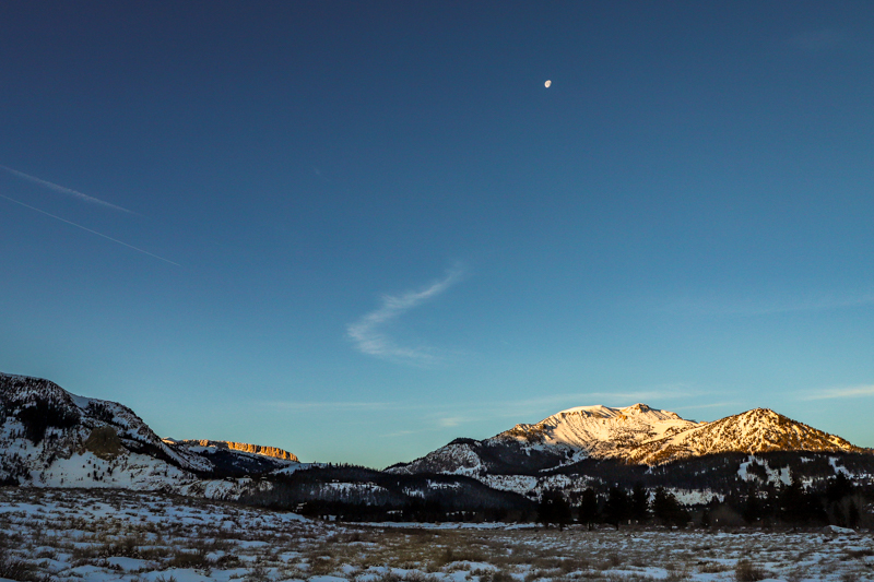 December 26 - Almost full moon as the sun rises over Mammoth Crest and Mammoth Mountain, Mammoth Lkes, CA.jpg
