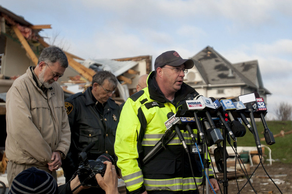 . Kirkland Fire Department Chief Connel speaks to the media after a tornado swept through the down the previous day on April 10, 2015 in Fairdale, Illinois. According to reports, 11 people were injured and one person was killed when tornadoes and thunderstorms passed through the northwestern suburbs of Chicago. (Photo by Jon Durr/Getty Images)