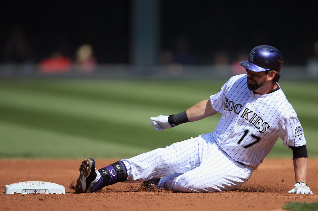 . Todd Helton #17 of the Colorado Rockies slides safely in to second base with a double off of starting pitcher Michael Wacha #52 of the St. Louis Cardinals in the second inning at Coors Field on September 19, 2013 in Denver, Colorado.  (Photo by Doug Pensinger/Getty Images)