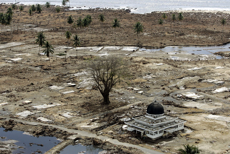 . A mosque remains among a village wiped out by tsunamis in Keude Teunom, Aceh province in northwestern Indonesia on Sunday, Jan. 2, 2005. Some 230,000 people were killed in the Indian Ocean tsunami set off by a magnitude 9.1 earthquake on Dec. 26, 2004. A dozen countries were hit, from Indonesia to India to Africa\'s east coast. Scores of Associated Press journalists covered the disaster, and as the 10th anniversary approached, the AP asked 10 of them to describe the images that have stuck with them the most. This is the ninth of their stories, which are being published daily through Dec. 26.  (AP Photo/Eugene Hoshiko, File)