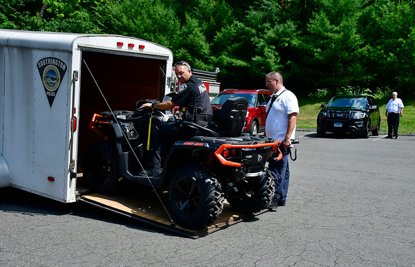 7/17/2019 Mike Orazzi | Staff Southington rescue personnel while rescuing an adolescent boy who was injured while hiking at Crescent Lake Wednesday afternoon. The boy sustained a head injury and was transported to an area hospital.