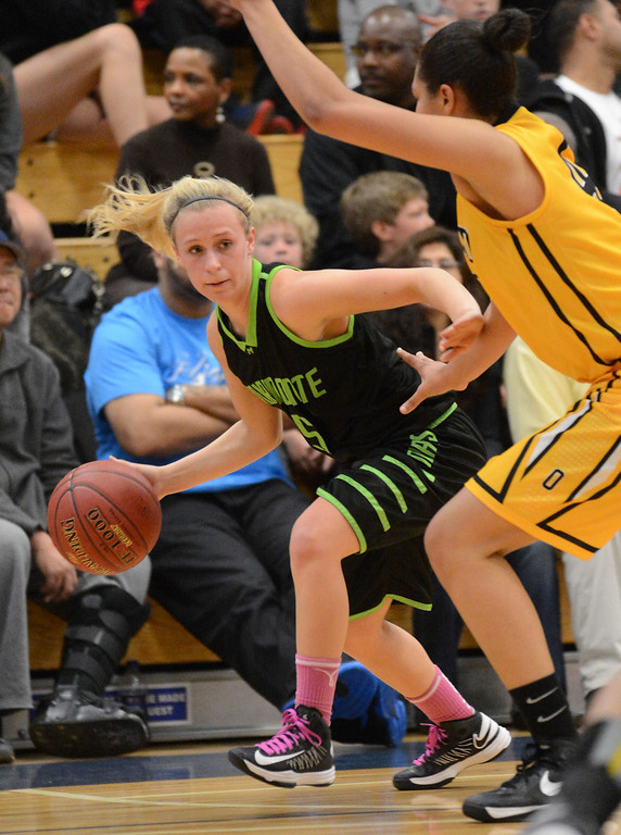. Miramonte High\'s Allison Miller (5) left, tries to get past Bishop O\'Dowd High\'s Breanna Brown (4) in the second period of their Division III North Coast Section basketball game in Dublin, Calif., on Saturday, March 2, 2013. Bishop O\'Dowd High went on to win the game 77-48. (Doug Duran/Staff)