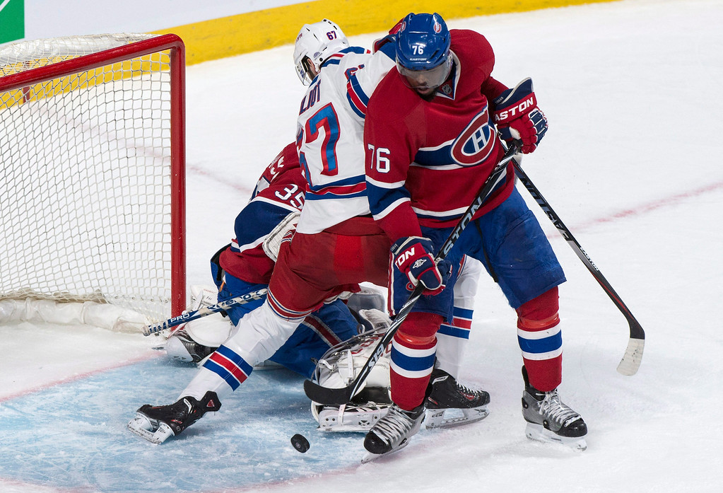 . Montreal Canadiens defenseman P.K. Subban clears the puck from in front of the net as goalie Dustin Tokarski gets caught up with New York Rangers\' Benoit Pouliot during the first period of Game 5 of the NHL hockey Stanley Cup playoffs Eastern Conference finals, Tuesday, May 27, 2014, in Montreal. (AP Photo/The Canadian Press, Paul Chiasson)