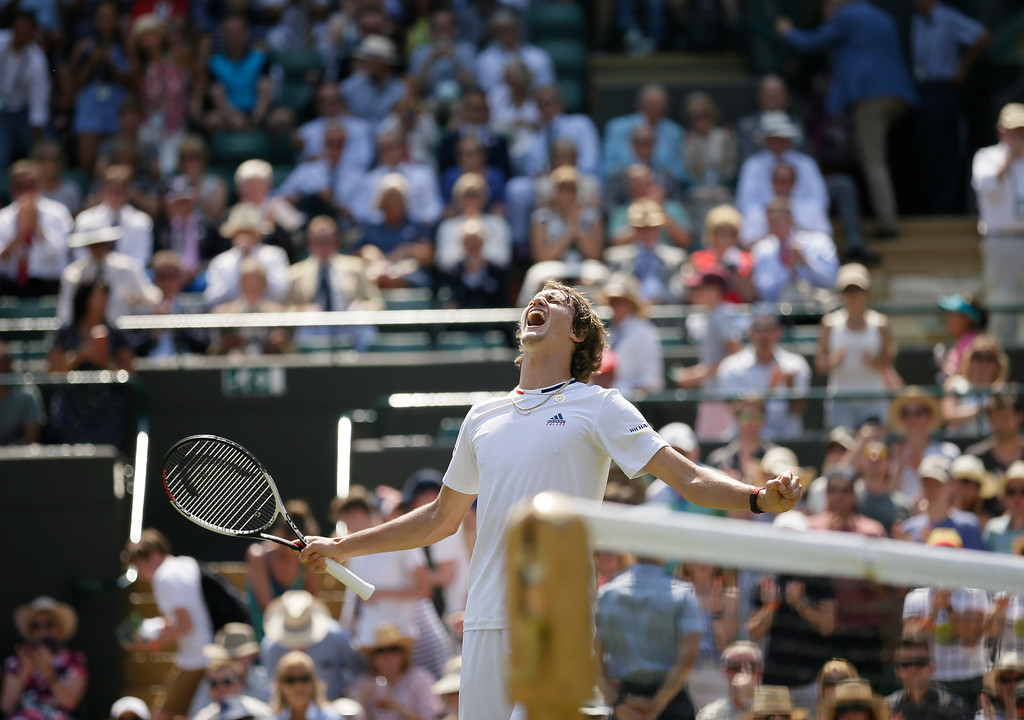 . Alexander Zverev of Germany celebrates defeating Taylor Fritz of the US in their men\'s singles match on the fifth day at the Wimbledon Tennis Championships in London, Friday July 6, 2018. (AP Photo/Tim Ireland)