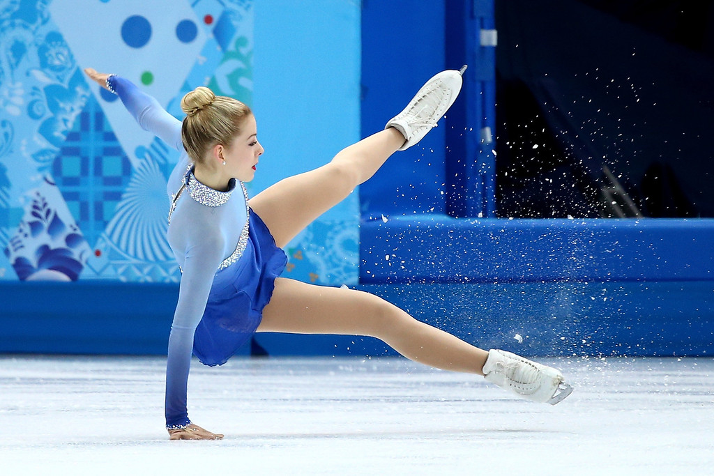 . Gracie Gold of the United States falls while competing in the Figure Skating Ladies\' Free Skating on day 13 of the Sochi 2014 Winter Olympics at Iceberg Skating Palace on February 20, 2014 in Sochi, Russia.  (Photo by Ryan Pierse/Getty Images)