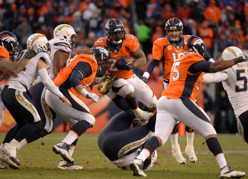 . Denver Broncos running back Knowshon Moreno (27) jumps through a hole during the third quarter. The Denver Broncos vs. The San Diego Chargers in an AFC Divisional Playoff game at Sports Authority Field at Mile High in Denver on January 12, 2014. (Photo by John Leyba/The Denver Post)