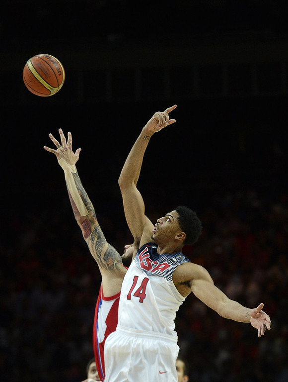 . Serbia\'s centre Miroslav Raduljica (L) vies with US centre Anthony Davis during the 2014 FIBA World basketball championships final match USA vs Serbia at the Palacio de los Deportes in Madrid on September 14, 2014.  GERARD JULIEN/AFP/Getty Images