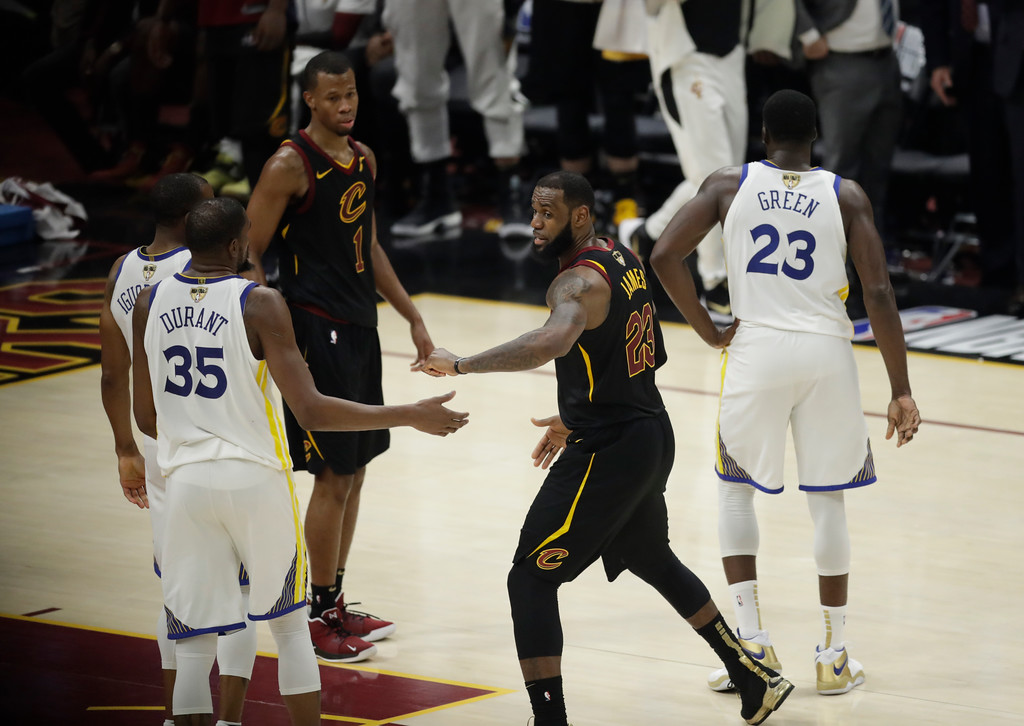 . Cleveland Cavaliers\' LeBron James (23) greets Golden State Warriors\' Kevin Durant (35) as James is taken out of the game in the second half of Game 4 of basketball\'s NBA Finals, Friday, June 8, 2018, in Cleveland. The Warriors defeated the Cavaliers 108-85. (AP Photo/Tony Dejak)