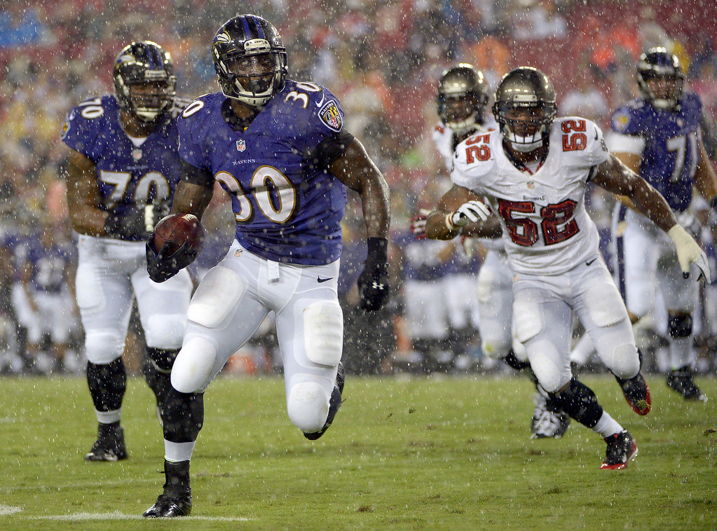 . Baltimore Ravens running back Bernard Pierce (30) scores on a second-quarter touchdown run after getting past Tampa Bay Buccaneers outside linebacker Jonathan Casillas (52)  during an NFL preseason football game Thursday, Aug. 8, 2013, in Tampa, Fla. (AP Photo/Phelan M. Ebenhack)
